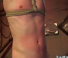 Bound submissive stud flogged by black dom