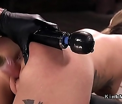 Tattooed blonde in strict device bondage tormented