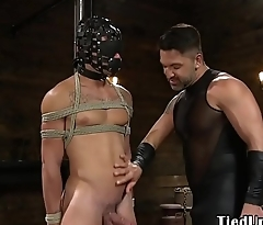 Spanked BDSM sub gets his hard dick tugged
