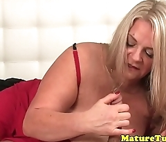 Curvy MILF tugging and teasing dick
