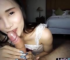 Asian ladyboy in a nurse uniform gives a POV handjob