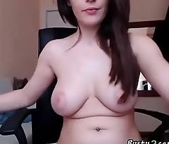 Brunette masturbating with a dildo