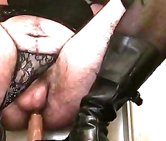 Moaning sissy in panties boots and gloves