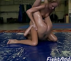 Wrestling lesbian straponfucked while oiled