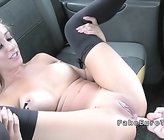 Brunette gets big cock in the ass in cab