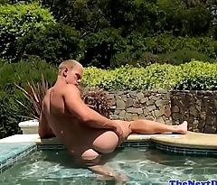 Husky stud wanking outdoors in the pool