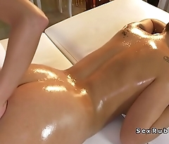 Lesbian masseuse fucks innocent busty babe