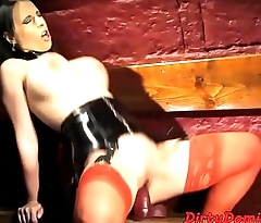 Busty dominatrix dildos herself passionately