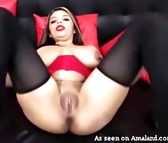 Amateur Latina playing with huge tits on webcam