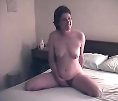 My wife posing nude more than the bed