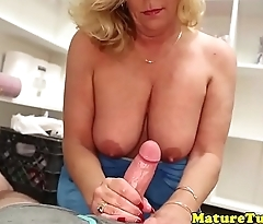 Mature stepmom tugging dick until climax