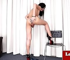 Solo ladyboy tugging her hard cock gently