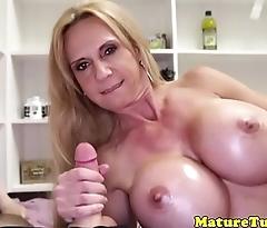 Handjob MILF makes cock cum POV style