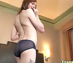 Ginger tgirl rubs her ass and jerks off